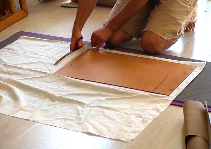 Cutting-canvas-cloth-for-making-canvas-panels-Damian-Osborne
