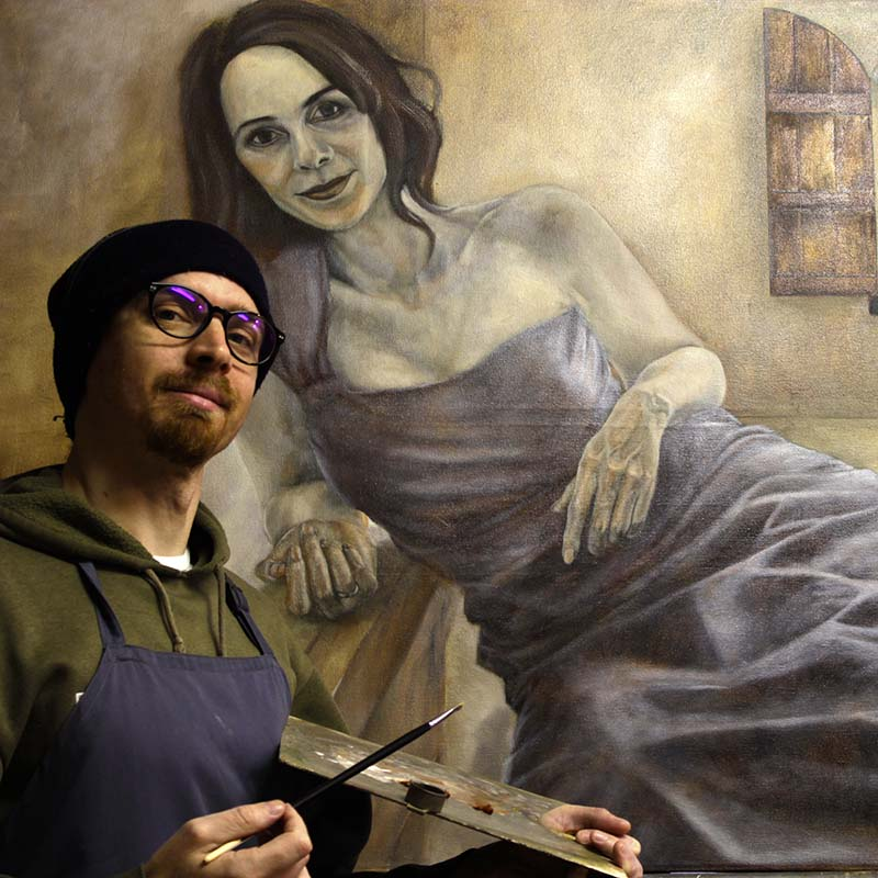 Painting the flesh tone, artist selfie with figure painting