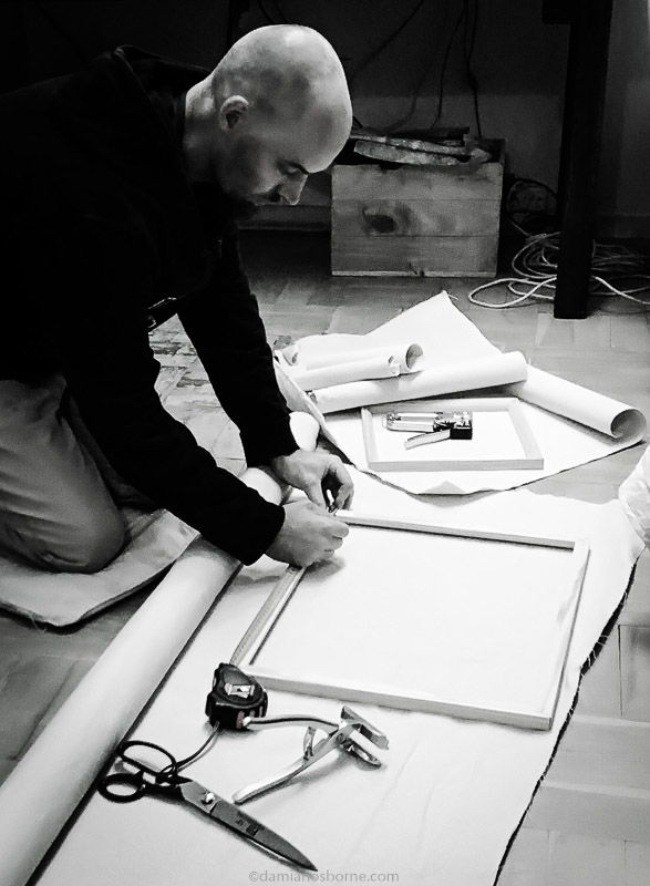 Artist stretching canvas, painting the traditional way, Damian Osborne