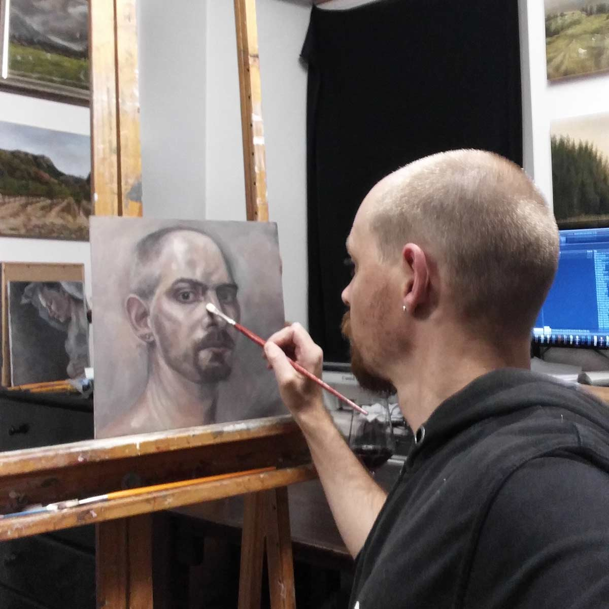 Artist painting self portrait